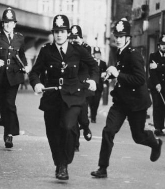 When did the police stop using wooden truncheons?